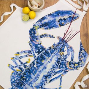 Iona Buchanan cottom apron with large blue lobster on a white background