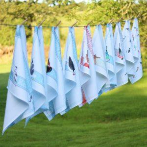 Iona Buchanan all tea towels pegged on washing line in garden