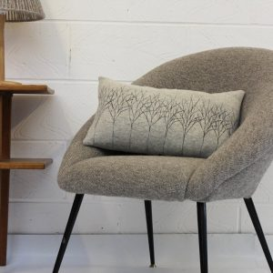 janie knitted textile merino wool cushion oblong cushion grey with tree effect stitching in a grey chair