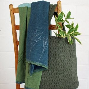 janie knitted textiles lambswool block scarf green light blue and dark blue line of trees stitched in light blue at one end