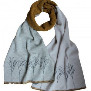 janie knitted textiles lambswool block scarf light brown on one side and light grey on the other side a line of trees stitched in light grey at one end