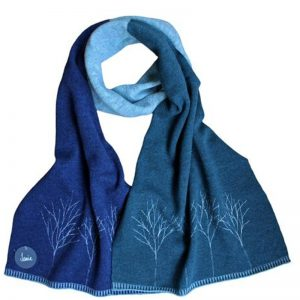 janie knitted textiles lambswool block scarf dark blue on one side and light blue on the other side a line of trees stitched in light blue at one end