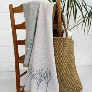 janie knitted textiles lambswool scarf grey with a line of tree stitched in dark grey at one end