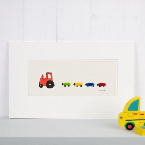 Penny Lindop red tractor being followed by 4 sheet each wtih green yellow blue and red fluffy sheep wool bodies