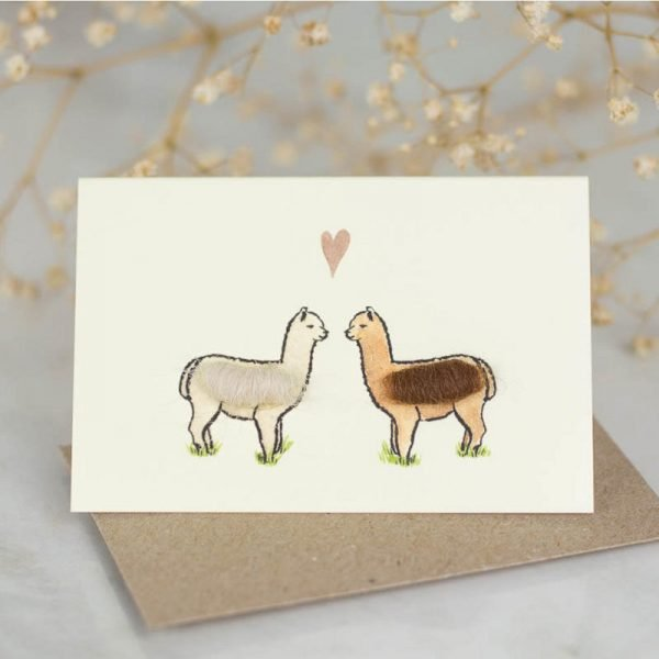 Penny Lindop gift card two fluffy kissing llamas below a love heart