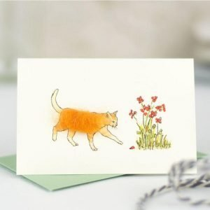Penny Lindop gift card ginger fluffy cat in garden by red wild flowers