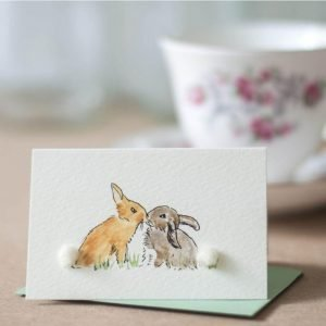 Penny Lindop gift card kissing rabbits with brown and grey fluffy sheep wool bodies