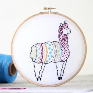 hooped embroidery kit stitched llama in sky blue purple and pink