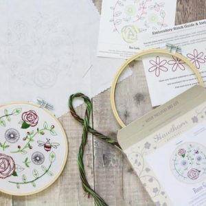 hooped embroidery kit stitched roses and bees in greens purples pinks