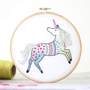 hooped embroidery kit unicorn stitched on sky blue purple and pink