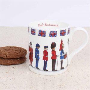 white china mug with illustration of iconic British uniform people police beef eater union jack trim around the rim