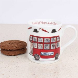 white china mug with illustration of red london bus and words land of hope and glory on the inside rim