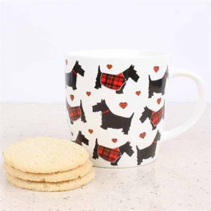 white china mug with illustration of scottie dogs some in tartan coats and love hearts