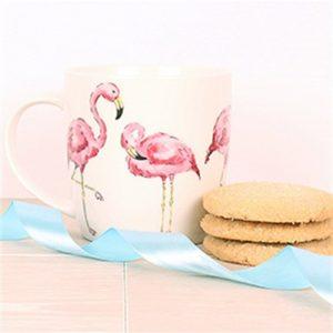 white china mug with illustration of three ink flamingos