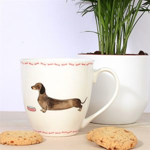 white china mug with illustrated dachshund on front and pink bone trim