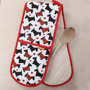 oven gloves with illustrated black scottie dogs finished with as red hem all the way round