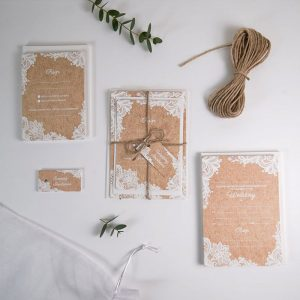 pack of wedding invitations brown with rustic lace pattern in white