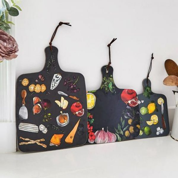 three blue chopping boards each with images of cheeses or fruits or garlic and lemons