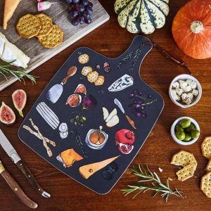 blue chopping board illustrated with cheeses biscuits grapes knife