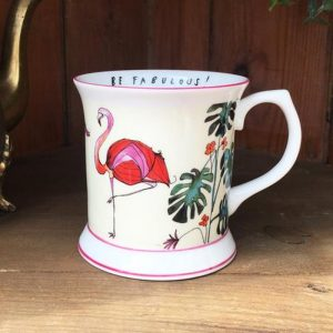 white china mug illustrated with pink flamingos and green leaves with caption on inside rim be fabulous