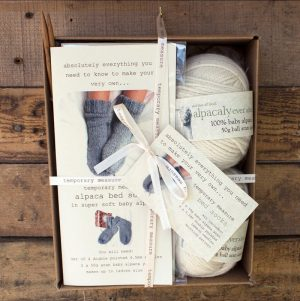 a gift box containing a knitting kit for a pair of lambswool socks