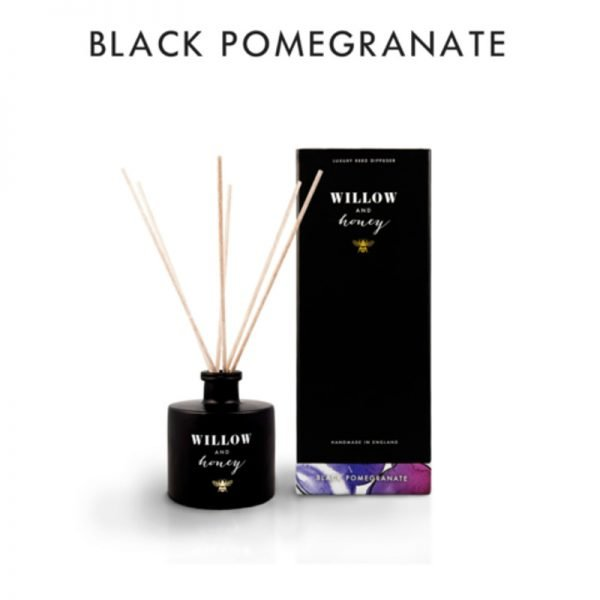 reed diffuser presented in black box fragrance black pomegranate