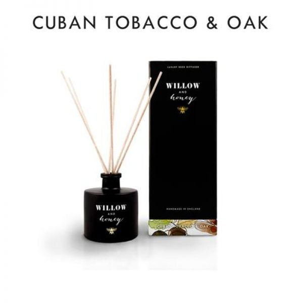 reed diffuser presented in black box fragrance cuban tobacco and oak