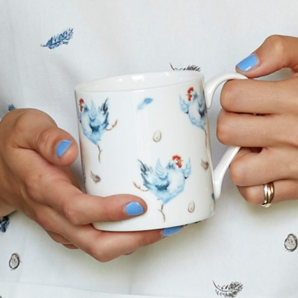 China Mug illustrated with blue chickens, feathers and eggs