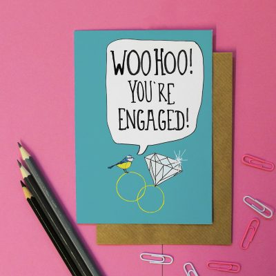 Blue card with blue tit sat on engagement ring large speach bubble saying Woo Hoo Your're Engaged