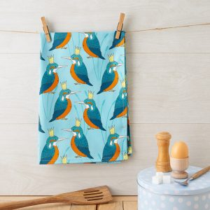 Tea Towel with a king fisher wearing a crown on light blue back ground