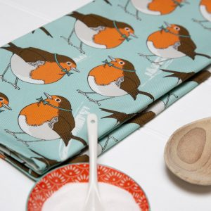 Tea Towel with a fat robin on light blue back ground