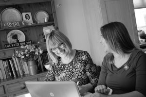Janet and Cathy working in office