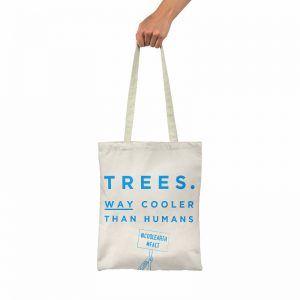 A white eco friendly tote bag stating that trees are cooler than humans #coolearth #fact
