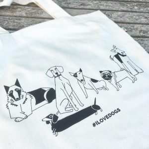 A white eco friendly tote bag stating #ilovedogs with illustrations of various dogs