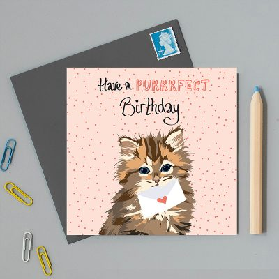 Happy Birthday Greeting Card with a pale pink background and an illustration of a little kitten holding an envelope with a heart