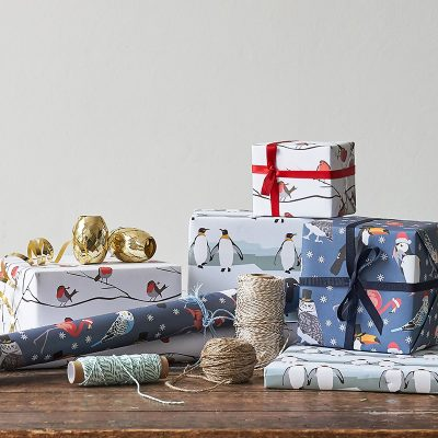Christmas presents wrapped up in Lorna Syson festive Christmas wrapping paper