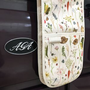 oven gloves on an aga featuring hedgehogs, butterfly's, bees and flowers