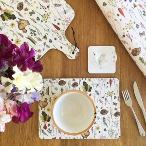 a table set with country inspired Annabel Rose placemat and chopping board