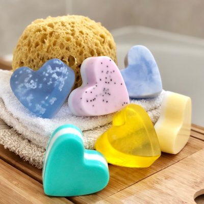 heart shaped vegan friendly soap in various colours on a table