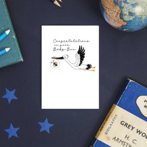 congratulations new baby greeting card with a stork carrying a bee in it's beak
