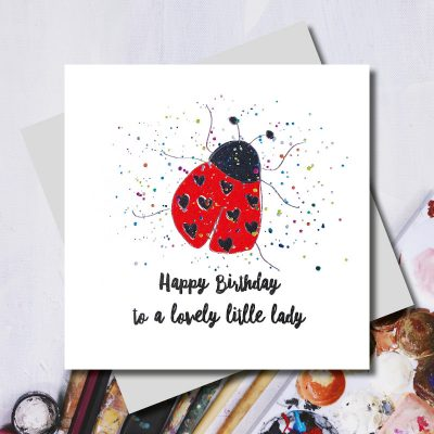 Happy birthday greeting card with an illustration of a ladybird on a spotty background