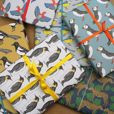 presents covered in colourful animal inspired wrapping paper