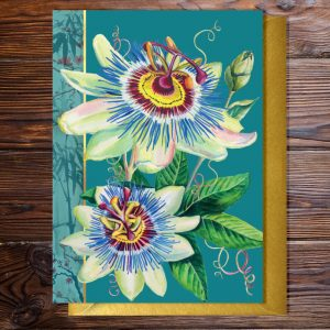 Greeting card featuring a passion flowers on a teal background