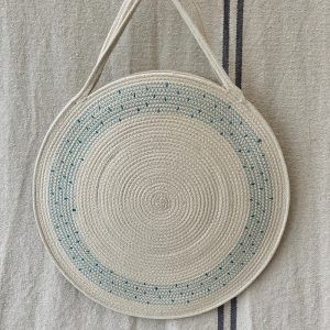 A circular bag made of unbleached cotton rope handmade made by Ruby Cubes