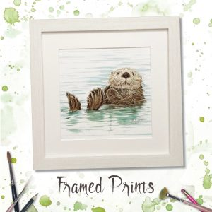 framed print of an otter on it's back in the water